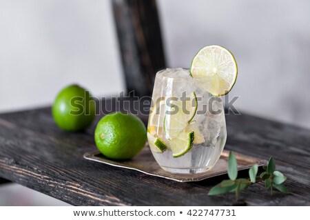 Fresh black soda with ice on wood table Stock photo © punsayaporn