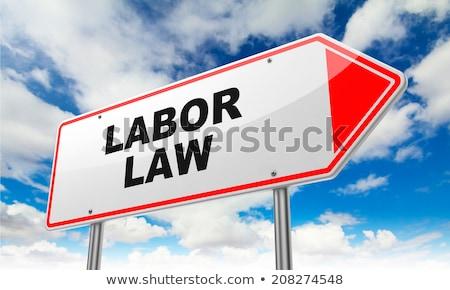 Labor Law on Red Road Sign. Stock photo © tashatuvango