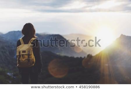 fiatal · hátizsákos · turista · áll · felső · hegy · siker - stock fotó © yongkiet