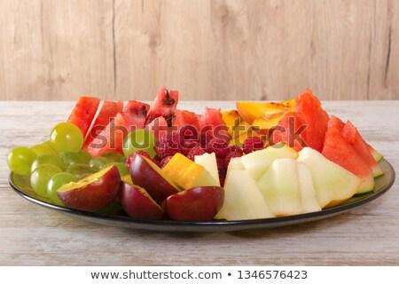 Plat fruits rouge vert pommes oranges Photo stock © raphotos