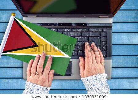 Kezek dolgozik laptop Guyana mutat képernyő Stock fotó © michaklootwijk