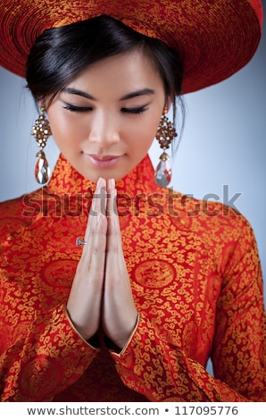 Young Vietnamese woman in a traditional hat Stock photo © smithore