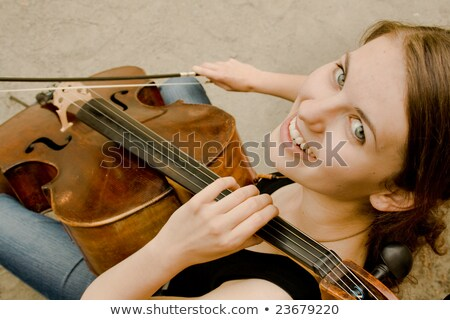 romantic girl playing cello stock photo © elisanth