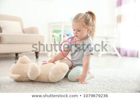 Little Girl Playing Doctor Stock photo © barabasa