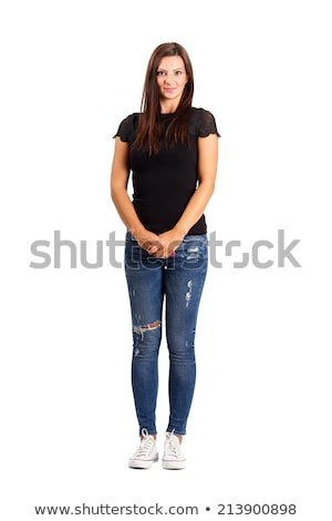 Smiling casual woman standing with her legs crossed  Stock photo © feedough
