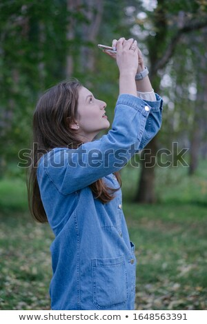 Hipster female photographer exploring autumn nature scenery Stock photo © stevanovicigor