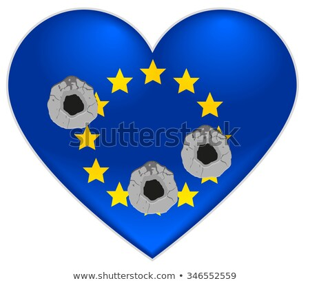 bullet holes in heart of european union flag stock photo © orensila