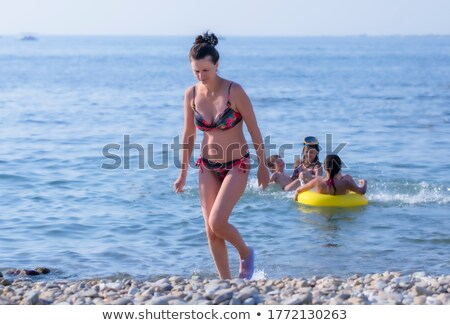 Young woman with the child ashore of sea Stock photo © Paha_L