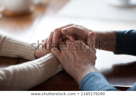 Happy senior husband and wife holding hands Stock photo © ozgur