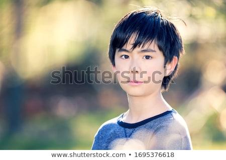 cool boy enjoys the afternoon sun Stock photo © meinzahn