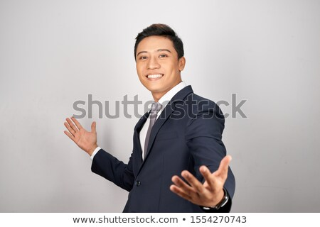 Young businessman with open arms isolated Stock photo © zurijeta