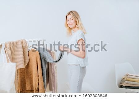 young blonde choosing what to put on stock photo © konradbak