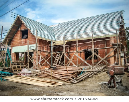 Roofer preparing wooden construction for the house Stock photo © zurijeta