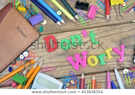 Don't Worry word and office tools on wooden table Stock photo © fuzzbones0