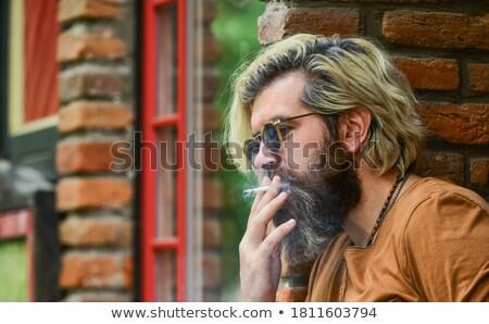 portret · aantrekkelijk · man · baard · naar · rechtstreeks - stockfoto © deandrobot