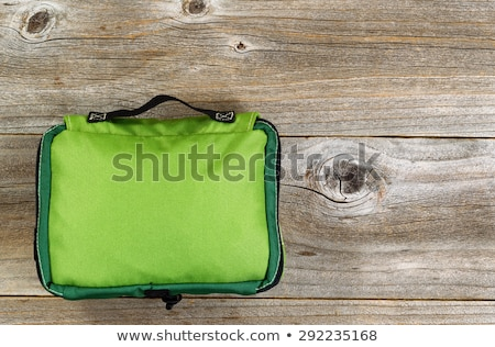 First aid medical bag on rustic wooden boards Stock photo © tab62