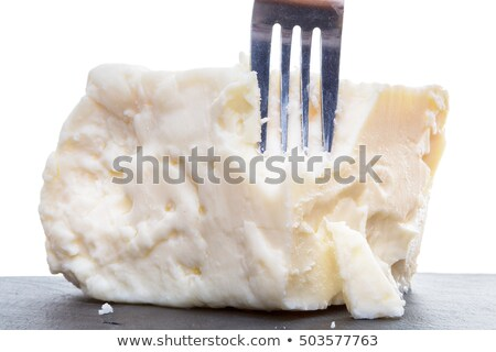 breaking semisoft crumbly feta with a fork stock photo © ozgur