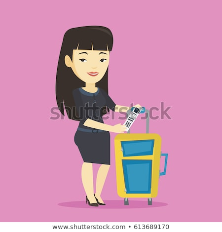 asian business woman showing luggage tag stock photo © rastudio