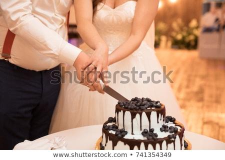 Bruid bruidegom gesneden cake bruidstaart voedsel Stockfoto © tekso