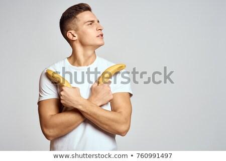 肖像 笑みを浮かべて 男 バナナ 白 ストックフォト © wavebreak_media