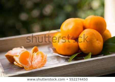 plate of ripe mandarin oranges stock photo © Digifoodstock