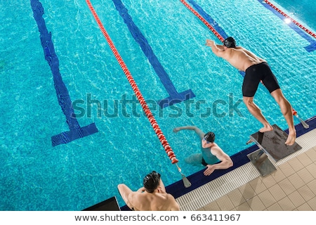 top view of a man diving from a starting block stock photo © deandrobot