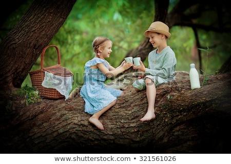 cute cheerful little girl in white dress and milk bottle Stock photo © Traimak