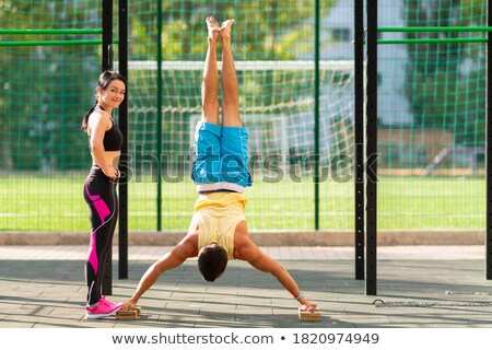 man performing handstand in park Stock photo © IS2