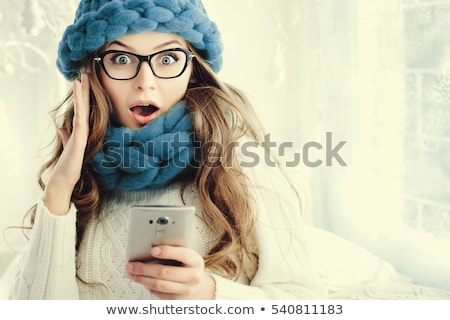 close up portrait of beautiful screaming young girl holding smar stock photo © deandrobot