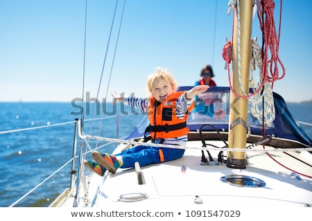 Boy on bow of yacht Stock photo © IS2