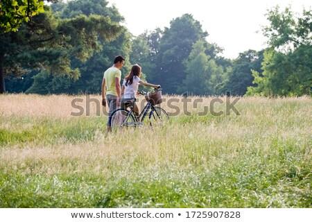 Pár sétál bicikli mező férfi nyár Stock fotó © IS2