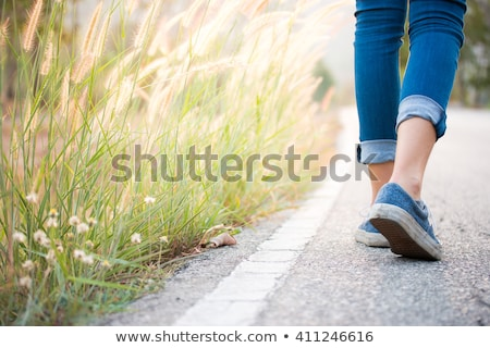 Woman with walker walking outdoors Stock photo © manaemedia