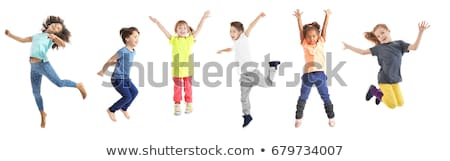 Cheerful little girl child jumping isolated Stock photo © deandrobot
