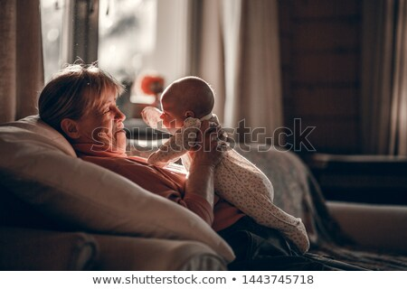 Grandmother holding granddaughters face Stock photo © IS2