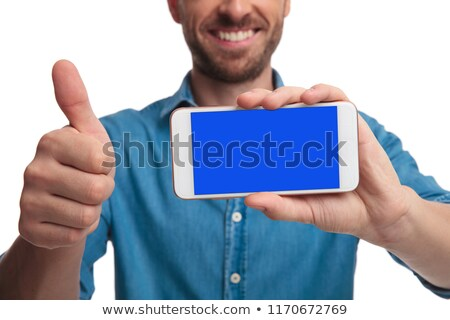 man showing the screen of a phne and makes ok stock photo © feedough