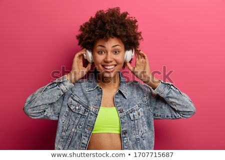 Excited afro girl posing on pink. stock photo © NeonShot