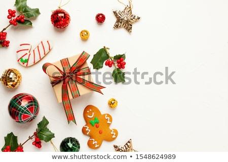 Karácsony ajándékdobozok mézeskalács sütik fenyőfa ág Stock fotó © karandaev
