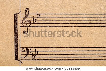 music notes on old paper sheet to use for the background stock photo © inxti