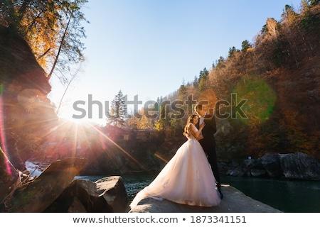 ifjú · pár · ölel · áll · erdő · naplemente · család - stock fotó © ruslanshramko