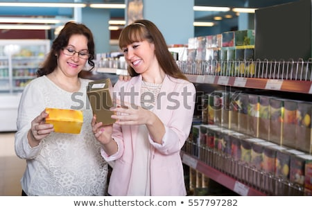 Stock photo: Female customer buying herbal tea