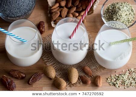 Vegan plant milks - almond milk, poppy seed milk and hemp seed milk stock photo © madeleine_steinbach
