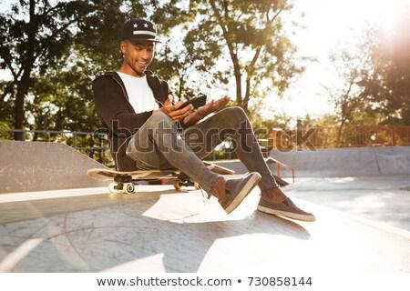 小さな スケート 男 座る 公園 ストックフォト © deandrobot