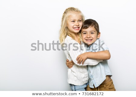 Cute girl 4-5 year old with brother posing in studio Stock photo © Lopolo