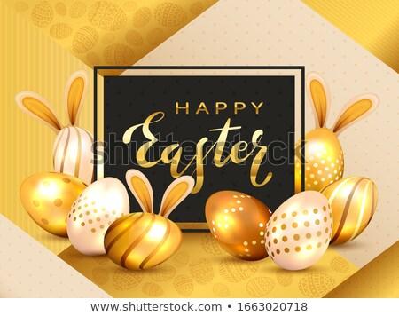 golden happy easter eggs hare ears stock photo © limbi007