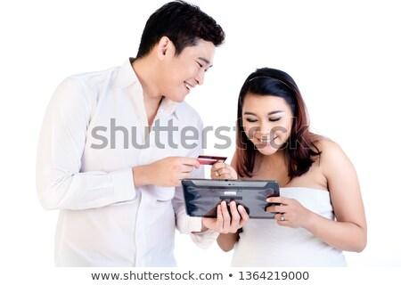 casal · digital · comprimido · sorridente · branco - foto stock © kzenon