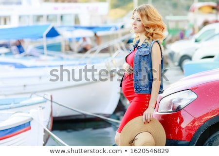 Pregnant woman in red shirt, hat, sunglasses and black trousers at yacht marina of Malta Stock photo © ElenaBatkova