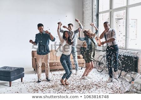 Dancing at home party Stock photo © pressmaster