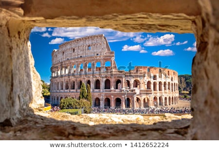 Colosseum of Rome scenic view through stone window Stock photo © xbrchx