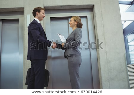 Businesspeople Discussing Standing Near Elevator Stock photo © AndreyPopov