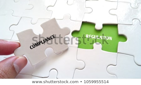 Stock photo: Compliance And Regulations Words On Jigsaw Puzzle